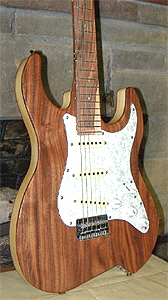 Walnut top with African Olive neck and Pistachio fingerboard by Rock Beach Guitars USA
