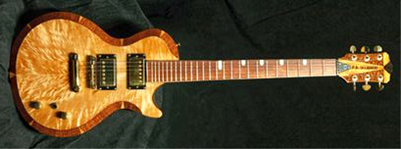 Custom 6 string guitar with Maple top by Peter Occhineri paocchineri@comcast.net USA